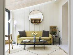 Charles Mellersh renvovation of Victorian terrace in Notting Hill, board and batten panelling, Matthew Hilton Habitat sofa, BDDW mirror | Remodelista
