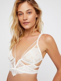 Etienne Lace Bralette | Sheer floral lace longline bralette with a wire V at the bust.    * Scalloped trim   * Crisscross adjustable straps   * Double S-hook closures   * Cutout detailing in back