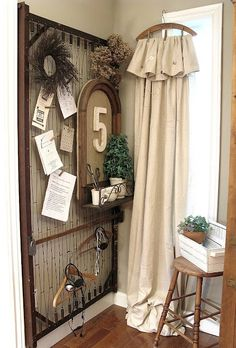 Bed springs, painters dropcloth hanger curtains...unusual? Yes!  Cute? Yes! tammiedonaldson