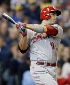 Cincinnati Reds' Joey Votto hits an RBI double in the ninth inning of a baseball game against the Milwaukee Brewers Wednesday.