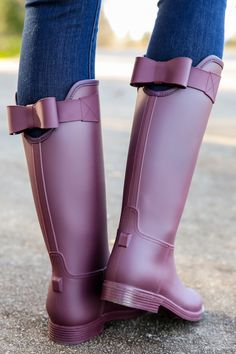 """What's makes a better splash than getting a gift that you weren't expecting?? Well look before you leap into the puddle as these rain boots come """"Sealed With A Bow"""" to make all your rainy days a little more """"Bowtiful""""!!! Rubber rain boots with a bow on the back at the opening. Made in China. Shaft measures 13"""" Opening measures 15"""""""