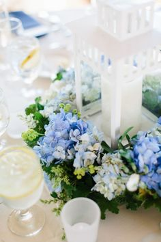 Lanterns with blue hydrangea at Regatta Place
