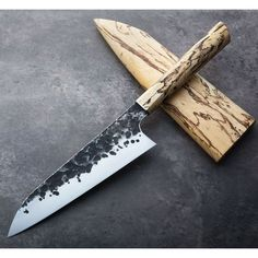 A beautiful, thin, light and tall hand-forged chef knife by James Oatley of Oatley Knives with forge-finished flats, tamarind wood handle and matching saya. Custom Kitchen Knives, Japanese Kitchen Knives, Custom Knives, Handmade Kitchen Knives, Kitchen Cutlery, Handmade Knives, Kitchen Tools, Kitchen Gadgets, Pocket Knife Brands