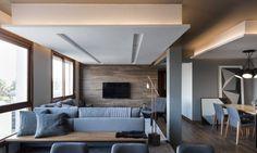 O cinza predomina no apartamento gaúcho com estofados e paredes em tons variados. A reforma integrou toda a parte social