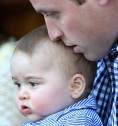 Future Kings;  Prince William gives his son Prince George a tender kiss as they watch animals at the zoo.