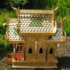 Thai spirit House.  Put this in your yard, and ghosts will reside in this ornate house rather than inside your home.