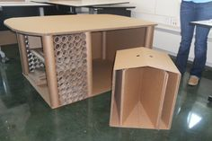Group one (Suzanne Ewalt, Mackenzie Hodgson & Abbey Morgenroth). Table with bookcase and folding stool.