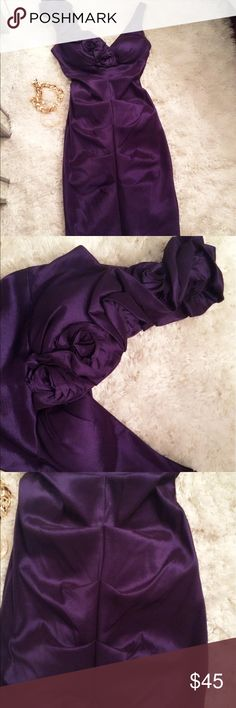 Formal Deep Purple Dress X scape brand size 4 dress: rose detail design along right shoulder. 59% poly,36% nylon and 5%spandex.,  approx 21 in from waist. Worn only one time Xscape Dresses Wedding