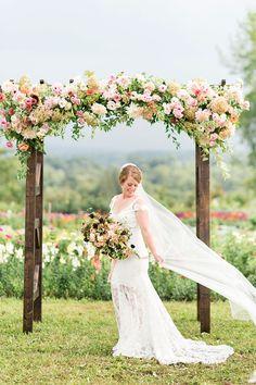 This is what happens when a florist gets married! #weddingflowers #weddinginspo #fallwedding see more: https://ruffledblog.com/sweet-backyard-wedding-backdrop-handcut-flowers