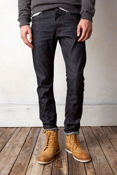 Blue/Black Fitted Denim Jeans, and Worn Work Boots. Men's Spring Summer Fashion.