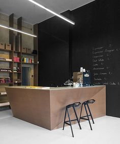 Love the look of this small cafe attached to a retail store, particularly the faceted counter and blackboard. Geszeft by Joanna Wołoszyn and Daria Barnaś