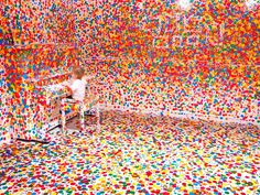 """Yayoi Kusama, """"The Obliteration Room"""" (participatory instillation; colored dot stickers applied by children)"""