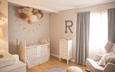 I love the dainty banners hanging over the crib and the gathered pom poms