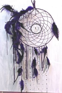 """""""Wiccan night"""" dreamcatcher with hematite, clear quartz and amethyst made by a Vancouver Island artist www.suzannart.com #suzannart #dreamcatcher #purple #feather #goodvibes #crystal #fibonacci Vancouver Island, Dream Catchers, Drawing Tips, Clear Quartz, Wiccan, Feather, Amethyst, Crystals, Night"""