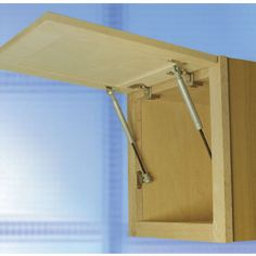 The Cabinet Door Swing-up Fittings - E-Z Open - Lid Stay can be used for a face frame application and is able to hold 22.5 lbs. or 33.7 lbs. The Lid Stay has a silver finish and features smooth motion and stopping.