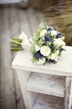 Beautiful bouquet of roses and Scottish thistles. Perfect for our wedding ceremony and color scheme.