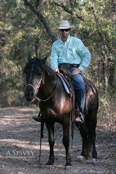 Robert Carlson- Paradise, Texas  Adopts & trains wild mustangs