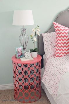 Painted trash can turned over as side table and makes for a perfect accent color.