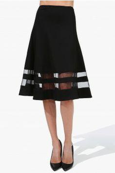 An elegant knee length skirt that has translucent detailing at hemline.