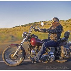 """gordonwiltsie As a photographer, it is a refreshing break to to shoot something completely out of your own box, like this Tibetan Buddhist #biker cruising back roads near #SantaFe, #NewMexico."""""""
