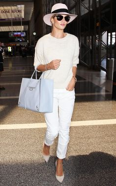 28 June Rosie Huntington-Whiteley jetted out of LAX airport in style, accenting her neutral ensemble with a baby blue Balenciaga tote and panama hat. Getty Images   - HarpersBAZAAR.co.uk