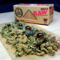 BHO, kief, and bud wrapped up in a RAW - www.delta9cloud.com