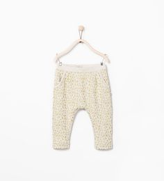 Image 1 of GOLD PRINT TROUSERS from Zara