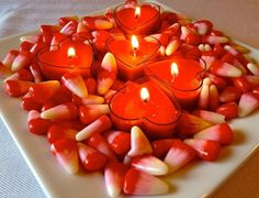 Bring out your heart-shaped candles and place it in a square plate with various decorations you can think of. Just be sure that it won't burn easily or at all. It can create the ambiance for a romantic dinner date.
