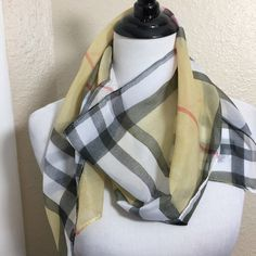 """New Sheer Tan & Black Plaid Designer Style Scarf New Sheer Tan & Black Plaid Fashion Scarf - this is a light weight, sheer scarf that is rectangular, long and would look cute as an accent to any outfit or double and  tie on your favorite handbag. Measures 60"""" by 15"""" Bundle for more savings. #London #designer #plaid #scarves Lovesdesigner Accessories Scarves & Wraps"""