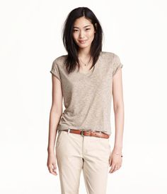 V-neck top in soft, linen-blend jersey. Short sleeves with sewn cuffs. Rounded hem.Linen-blend Top $17.99
