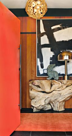 midcentury awesomeness - driftwood, orange, brass, wood paneling, abstract art, gosh I love it all