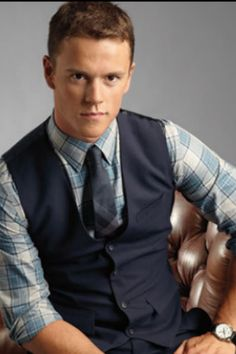 Love the plaid with the vest!