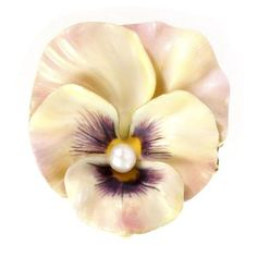 An antique enamel and pearl pansy brooch with a single 3mm pearl to centre. £2,500 by Bentley & Skinner