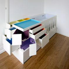 Ma.Mo.- Sunya Studio - Lisbon based Sunya Studio have designed this piece of children's furniture featuring fold out coloured compartments. Called Ma.Mo., the piece is designed for 0 to 12 year olds, with an integrated cot and a slide out bed. The piece also incorporates storage, a desk and a fold out changing table. Ma.Mo. is constructed from MDF and finished in matte lacquer.