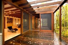Back porch/pergola and screened in area. I love the large sliding doors with screens to make the indoors and outdoors one space if you wanted.