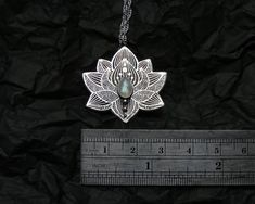Lotus Necklace - Water Lily Necklace is handmade piece. Its made of sterling silver in sawing, etching/engraving and soldering techniques. All patterns are unique, designed and applied by me. Central accent of the necklace is beautiful rainbow moonstone cabochon. Please note, this is made