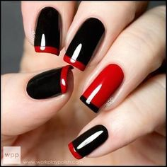Black glossy nails with red tips and red accent nail. This is the hotness.