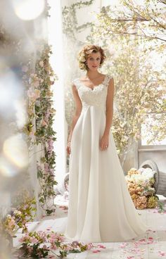 Mori Lee Voyage 6778 is a gorgeous A-line gown. It features a chiffon skirt with a short train. This gown also features a gorgeous bodice with alencon lace covering the entire bodice. This gown has alencon lace sleeves with a deep v in the back.
