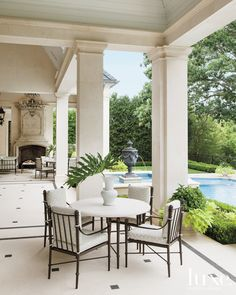 Here, a French, Neoclassical-Style residence in Dallas.   A mounted urn water feature holds interest poolside, where landscape architect Harold Leidner used a variety of lush plantings, including boxwood and azaleas, to bestow color and visual appeal.  See more: http://www.luxesource.com.
