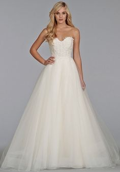 Ivory tulle ball gown with Venice lace bodice, strapless sweetheart neckline, full tulle skirt with chapel train.