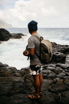 In this post, we're sharing our favorite things to do in Kauai – all inclusive with gorgeous beaches, stunning vistas, and breathtaking waterfalls! This post has everything you need to have the adventure of a lifetime in Hawaii! Berty Mandagie is wearing black chaco sandals, krochet kids white t-shirt, hawaiian board shorts, ONA Bag The Camp's Bay, and krochet kids blue beanie.