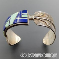"""Metal: Silver Metal Purity: .925 Hallmark: Sterling V V Artisan: Unidentified Tribe Affiliation: Zuni Wearable Length ( inches ): 6.75 including gap 1.25"""" Width ( inches / mm ): 1.05 / 26.8 Weight ( g"""