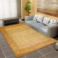 The rug's main design features symmetrical curved lines knotted around floral motifs; its borders are filled with more intricate patterns that mimic and complement the central elements. #goldrugs #buygoldrugs #buygoldrugsonline #rugknots Area Rugs Cheap, Cheap Rugs, Aubusson Rugs, Weaving Process, Curved Lines, Oriental Design, Floral Motif, Persian Rug, Rugs Online