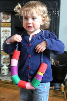Toddler threading activity with cardboard tube beads