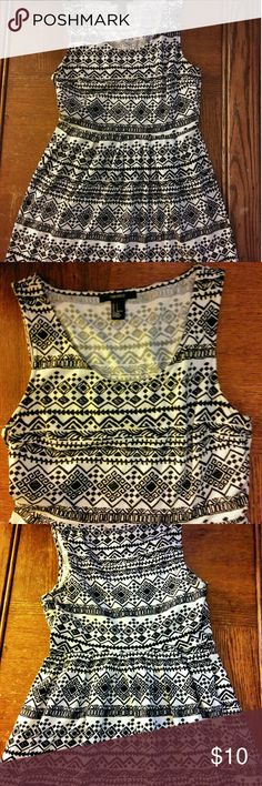 Forever 21 cute mini dress Adorable sleeveless black and white tribal print dress. cuts at the waist pleated so you get a little kick it's right above the knee very comfortable lightweight great for summer can dress up or down Forever 21 Dresses