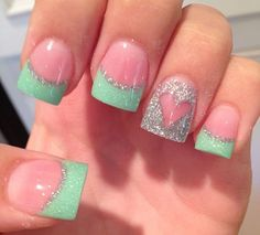 This is a very funky and playful French manicure that you should definitely try out. The nails are coated with light pink polish and tipped with thick sea green coating. The area between the tip and the base is then lined with silver glitters, plus a heart shaped accent of silver glitters.