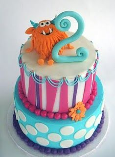 colorful birthday cake- I'd loose the pink and flowers and make it boy! But SO cute!