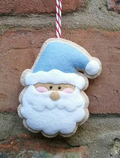 Here is my adorable handmade Santa ornament. It has been made from 100% wool felt, which is the best quality felt you can buy. It has been hand