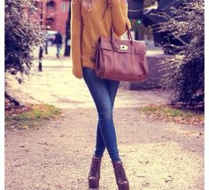 yellow sweater, skinny jeans, big purse.
