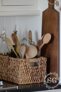 The woven texture of the basket and the wooden spoons bring some Autumn warmth to my kitchen!  The basket also holds assorted flavor oils and salts.